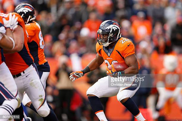 Running back CJ Anderson of the Denver Broncos rushes the football against the New England Patriots during the AFC Championship game at Sports...