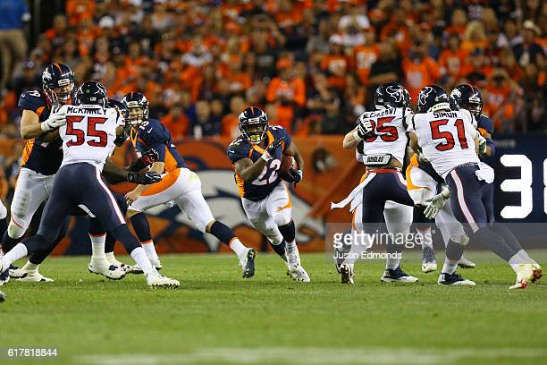 Running back CJ Anderson of the Denver Broncos rushes through an open hole in the second quarter of the game against the Houston Texans at Sports...