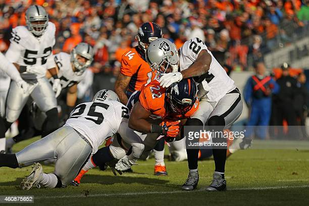 Running back CJ Anderson of the Denver Broncos scores a first quarter touchdown after an 11 yard rush against the Oakland Raiders at Sports Authority...