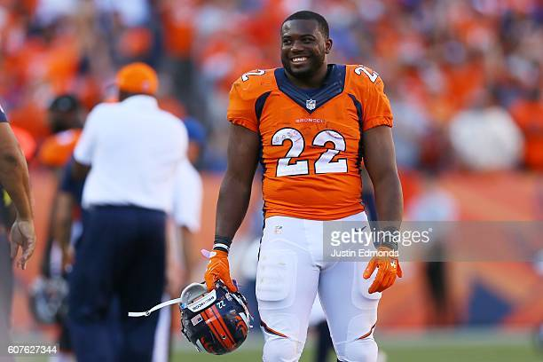 Running back CJ Anderson of the Denver Broncos smiles on the sideline of the second half of the game against the Indianapolis Colts at Sports...