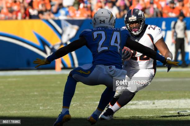 Running back CJ Anderson of the Denver Broncos tries to break to the inside against cornerback Trevor Williams of the Los Angeles Chargers in the...