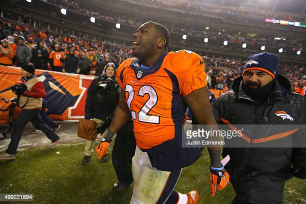 Running back CJ Anderson of the Denver Broncos walks off of the field after defeating the New England Patriots 3024 in overtime at Sports Authority...
