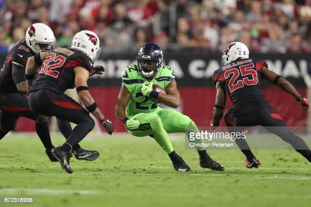 Running back CJ Prosise of the Seattle Seahawks carries the football against free safety Tyrann Mathieu and defensive back Tramon Williams of the...