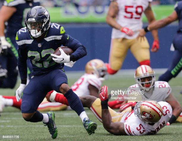 Running back CJ Prosise of the Seattle Seahawks escapes linebacker NaVorro Bowman of the San Francisco 49ers in the first quarter of the game at...