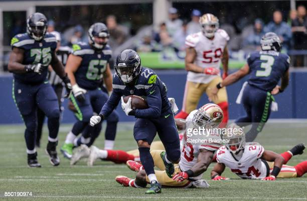 Running back CJ Prosise of the Seattle Seahawks escapes the grasp of linebacker NaVorro Bowman of the San Francisco 49ers during a game at...