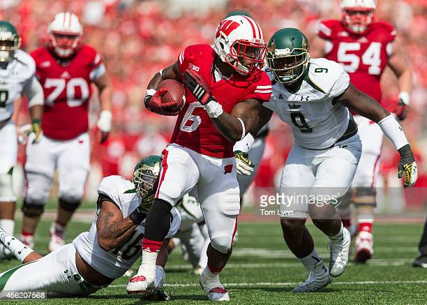 Running back Corey Clement of the Wisconsin Badgers breaks a tackle against linebacker Reshard Cliett of the South Florida Bulls during the third...