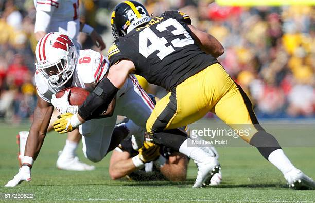 Running back Corey Clement of the Wisconsin Badgers is brought down by linebacker Josey Jewell of the Iowa Hawkeyes in the fourth quarter on October...