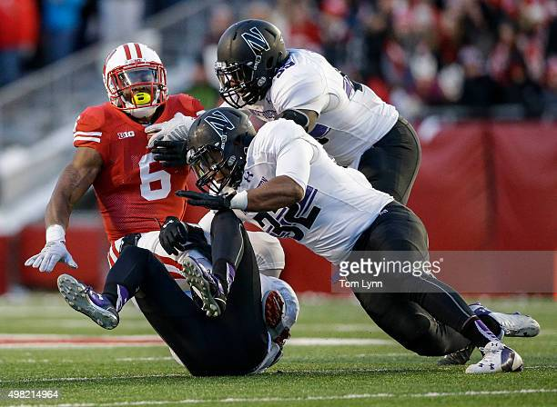 Running back Corey Clement of the Wisconsin Badgers is tackled by Nate Hall of the Northwestern Wildcats on November 21 2015 at Camp Randall Stadium...