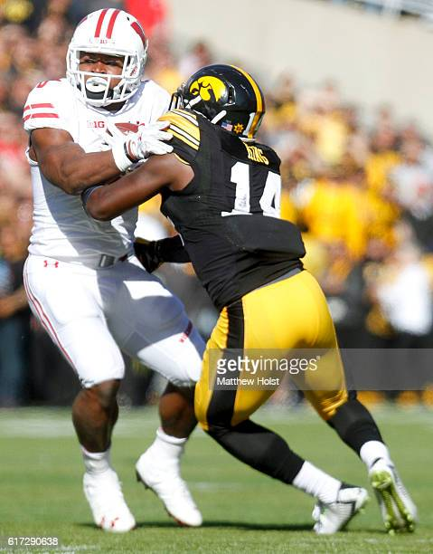 Running back Corey Clement of the Wisconsin Badgers pushes past defensive back Desmond King of the Iowa Hawkeyes in the second quarter on October 22...