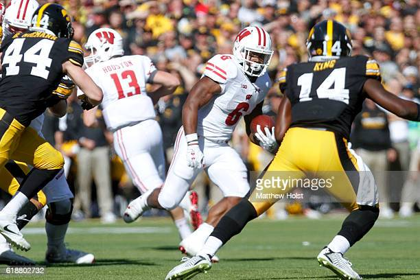 Running back Corey Clement of the Wisconsin Badgers runs in front of defensive back Desmond King of the Iowa Hawkeyes in the second quarter on...