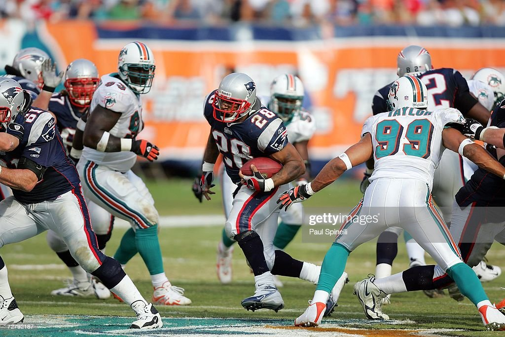 Running back Corey Dillon #28 of the New England Patriots runs the ball in traffic against the Miami Dolphins at Dolphin Stadium on December 10, 2006 in Miami, Florida. The Dolphins defeated the Patriots 21-0.