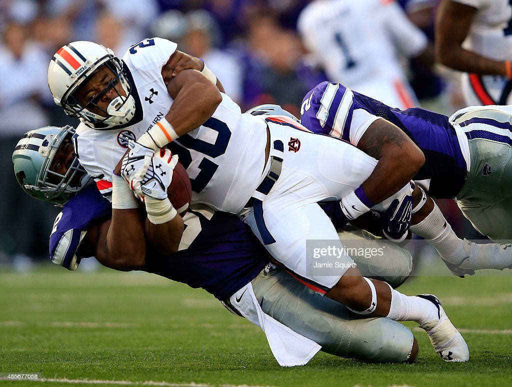 Running back Corey Grant of the Auburn Tigers carries the ball during the game against the Kansas State Wildcats at Bill Snyder Family Football...