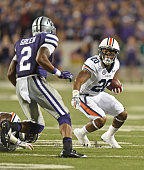 Running back Corey Grant of the Auburn Tigers rushes up field against strong safety Travis Green of the Kansas State Wildcats during the second half...