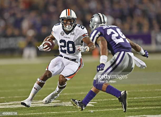 Running back Corey Grant of the Auburn Tigers rushes up field against defensive back Nate Jackson of the Kansas State Wildcats during the second half...