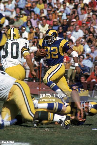 Running back Cullen Bryant of the Los Angeles Rams runs upfield in an NFL game against the Green Bay Packers at the Los Angeles Memorial Coliseum on...
