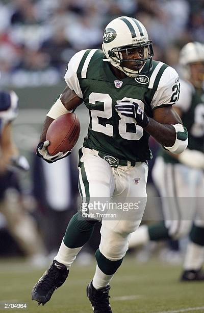 Running back Curtis Martin of the New York Jets rushes for yards against the Buffalo Bills during the game at Giants Stadium on October 12 2003 in...