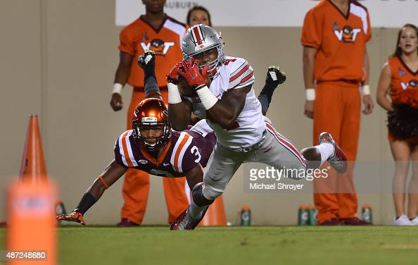 Running back Curtis Samuel of the Ohio State Buckeyes catches a touchdown pass while being defended by cornerback Greg Stroman of the Virginia Tech...