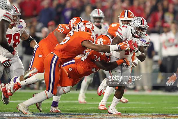 Running back Curtis Samuel of the Ohio State Buckeyes rushes the football past linebacker Kendall Joseph of the Clemson Tigers during the Playstation...