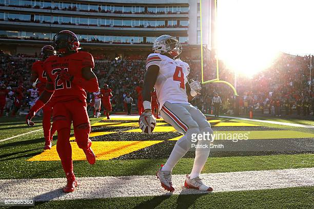 Running back Curtis Samuel of the Ohio State Buckeyes scores a touchdown against the Maryland Terrapins in the first quarter at Capital One Field at...