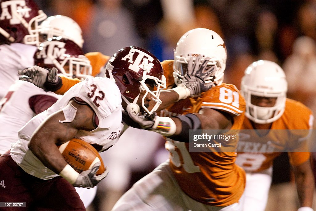 Running back Cyrus Gray #32 of Texas A&M holds off University of Texas defensive end Sam Acho #81 during the second half at Darrell K. Royal-Texas Memorial Stadium on November 25, 2010 in Austin, Texas.