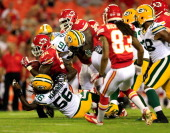 Running back Cyrus Gray of the Kansas City Chiefs carries the ball during the preseason game against the Green Bay Packers at Arrowhead Stadium on...