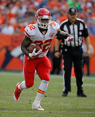Running back Cyrus Gray of the Kansas City Chiefs carries the ball against the Denver Broncos at Sports Authority Field at Mile High on September 14...