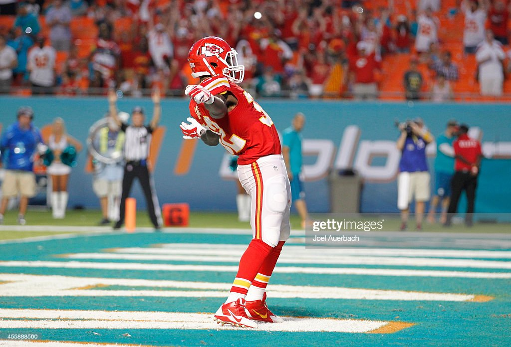 Running back <a gi-track='captionPersonalityLinkClicked' href=/galleries/search?phrase=Cyrus+Gray&family=editorial&specificpeople=5573455 ng-click='$event.stopPropagation()'>Cyrus Gray</a> #32 of the Kansas City Chiefs celebrates his fourth-quarter touchdown against the Miami Dolphins in their game at Sun Life Stadium on September 21, 2014 in Miami Gardens, Florida.