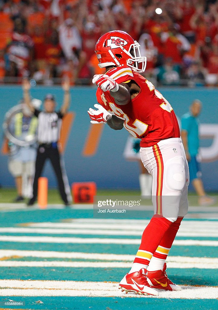 Running back Cyrus Gray #32 of the Kansas City Chiefs celebrates his fourth quarter touchdown against the Miami Dolphins in their game at Sun Life Stadium on September 21, 2014 in Miami Gardens, Florida.