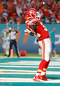 Running back Cyrus Gray of the Kansas City Chiefs celebrates his fourth quarter touchdown against the Miami Dolphins in their game at Sun Life...