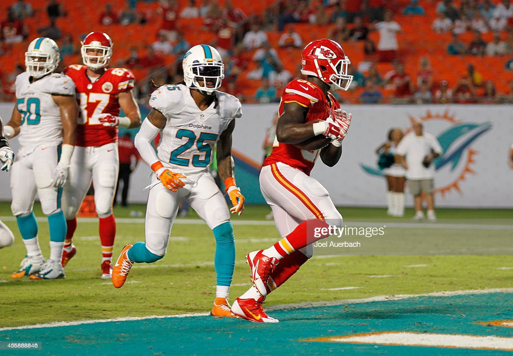 Running back Cyrus Gray #32 of the Kansas City Chiefs scores a fourth-quarter touchdown against the Miami Dolphins in their game at Sun Life Stadium on September 21, 2014 in Miami Gardens, Florida.