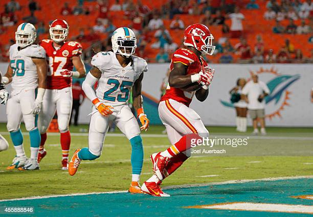 Running back Cyrus Gray of the Kansas City Chiefs scores a fourthquarter touchdown against the Miami Dolphins in their game at Sun Life Stadium on...
