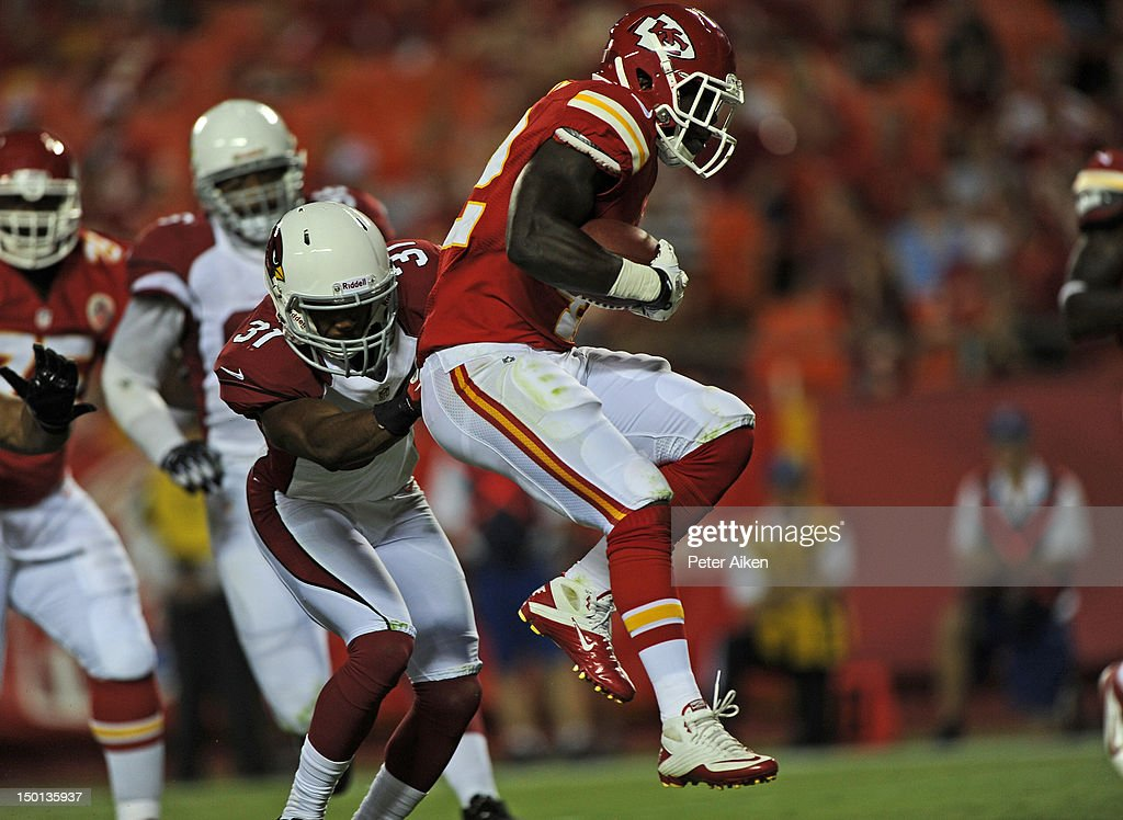 Running back Cyrus Gray #42 of the Kansas City Chiefs scrambles for a touchdown by safety Justin Bethel #31 of the Arizona Cardinals during the second half on August 10, 2012 at Arrowhead Stadium in Kansas City, Missouri. Kansas City defeated Arizona 27-17.