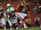 Running back Cyrus Gray of the Kansas City Chiefs scrambles for a touchdown by safety Justin Bethel of the Arizona Cardinals during the second half...