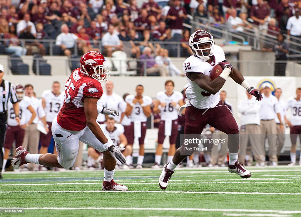 Running back Cyrus Gray #32 of the Texas A&M Aggies rushes during the game against the Arkansas Razorbacks at Cowboys Stadium on October 1, 2011 in Arlington, Texas.