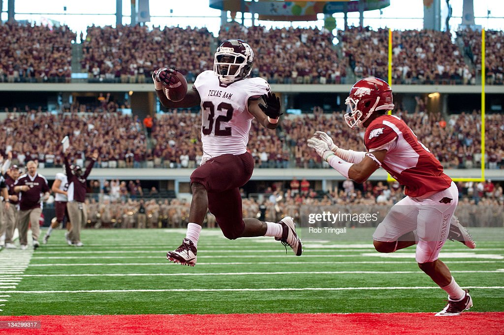 Running back Cyrus Gray #32 of the Texas A&M Aggies rushes for a touchdown during the game against the Arkansas Razorbacks at Cowboys Stadium on October 1, 2011 in Arlington, Texas.