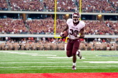 Running back Cyrus Gray of the Texas AM Aggies rushes for a touchdown during the game against the Arkansas Razorbacks at Cowboys Stadium on October 1...