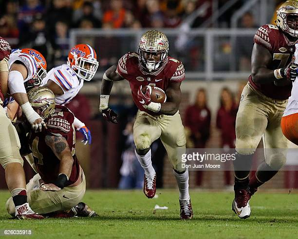 Running back Dalvin Cook of the Florida State Seminoles breaks free up the middle on a running play during the game against the Florida Gators at...