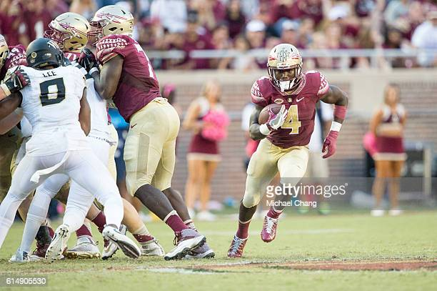 Running back Dalvin Cook of the Florida State Seminoles runs the ball through traffic during their game against the Wake Forest Demon Deacons at Doak...