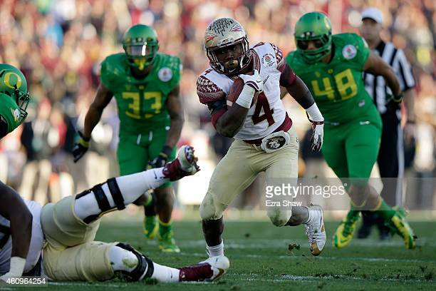 Running back Dalvin Cook of the Florida State Seminoles rushes with the ball against the Oregon Ducks during the College Football Playoff Semifinal...