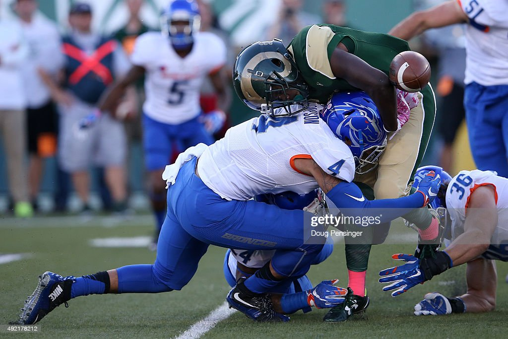 Running back Dalyn Dawkins #1 of the Colorado State Rams fumbles the ball as he is tackled by Darian Thompson #4 of the Boise State Broncos and was recovered by Tyler Horn #69 of the Boise State Broncos in the first quarter at Sonny Lubick Field at Hughes Stadium on October 10, 2015 in Fort Collins, Colorado.