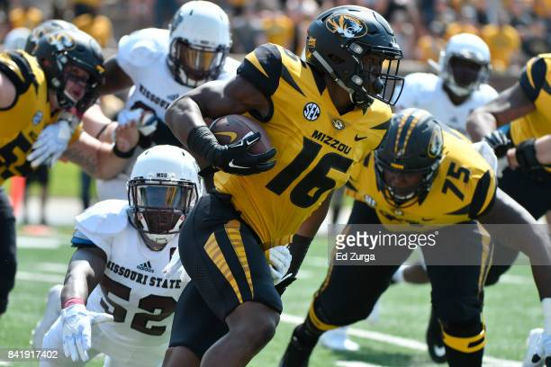 Running back Damarea Crockett of the Missouri Tigers rushes against McNeece Egbim of the Missouri State Bears in the second quarter at Memorial...