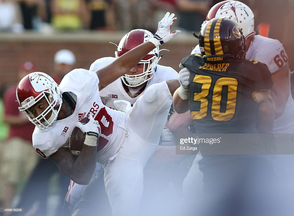 Running back D'Angelo Roberts #20 of the Indiana Hoosiers dives through the Missouri Tigers defensive line in the fourth quarter at Memorial Stadium on September 20, 2014 in Columbia, Missouri. Indiana won 31-27.