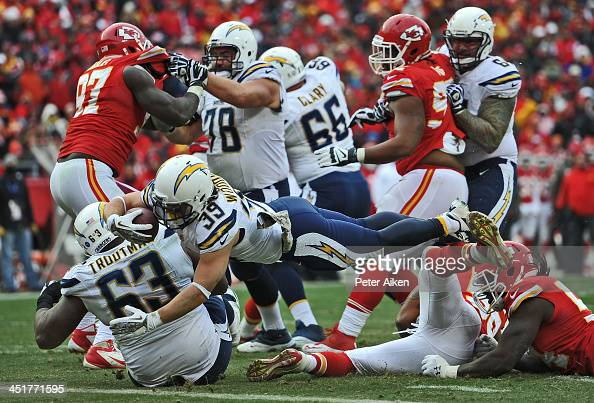Running back Danny Woodhead of the San Diego Chargers dives over the goal line for a touchdown against the Kansas City Chiefs during the second half...