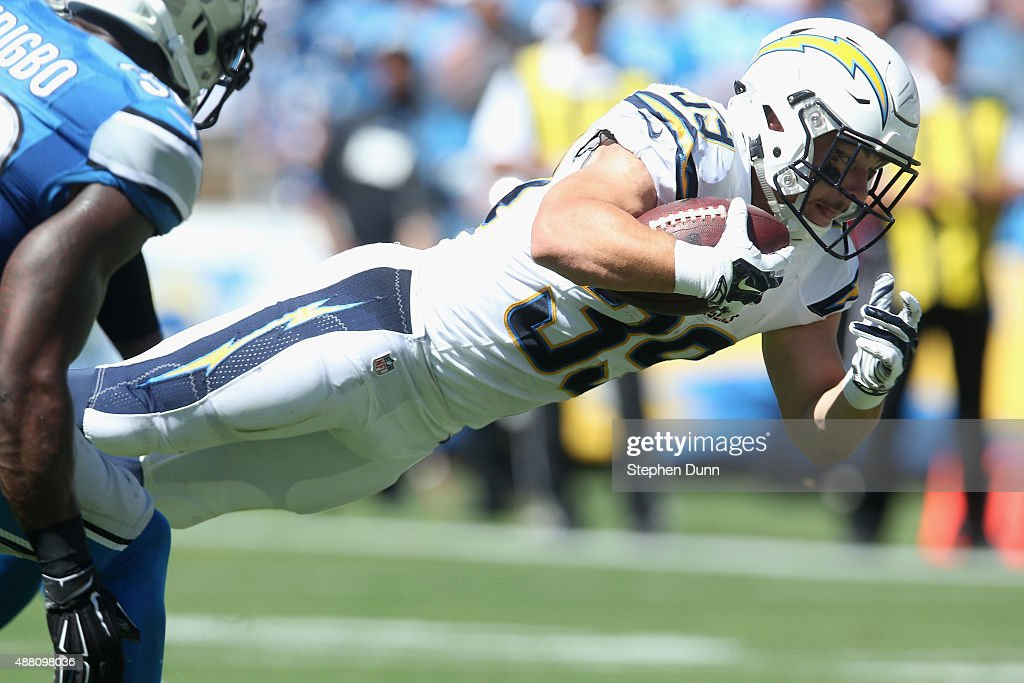 Running back <a gi-track='captionPersonalityLinkClicked' href=/galleries/search?phrase=Danny+Woodhead&family=editorial&specificpeople=4536267 ng-click='$event.stopPropagation()'>Danny Woodhead</a> #39 of the San Diego Chargers scores a touchdown against the Detroit Lions defense at Qualcomm Stadium on September 13, 2015 in San Diego, California.