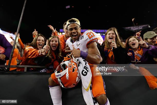 Running back Darien Rencher of the Clemson Tigers celebrates after defeating the Alabama Crimson Tide 3531 to win the 2017 College Football Playoff...