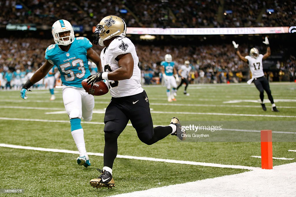 Running back <a gi-track='captionPersonalityLinkClicked' href=/galleries/search?phrase=Darren+Sproles&family=editorial&specificpeople=583154 ng-click='$event.stopPropagation()'>Darren Sproles</a> #43 of the New Orleans Saints scores on a 13-yard touchdown catch in the second quarter against the Miami Dolphins at the Mercedes-Benz Superdome on September 30, 2013 in New Orleans, Louisiana.
