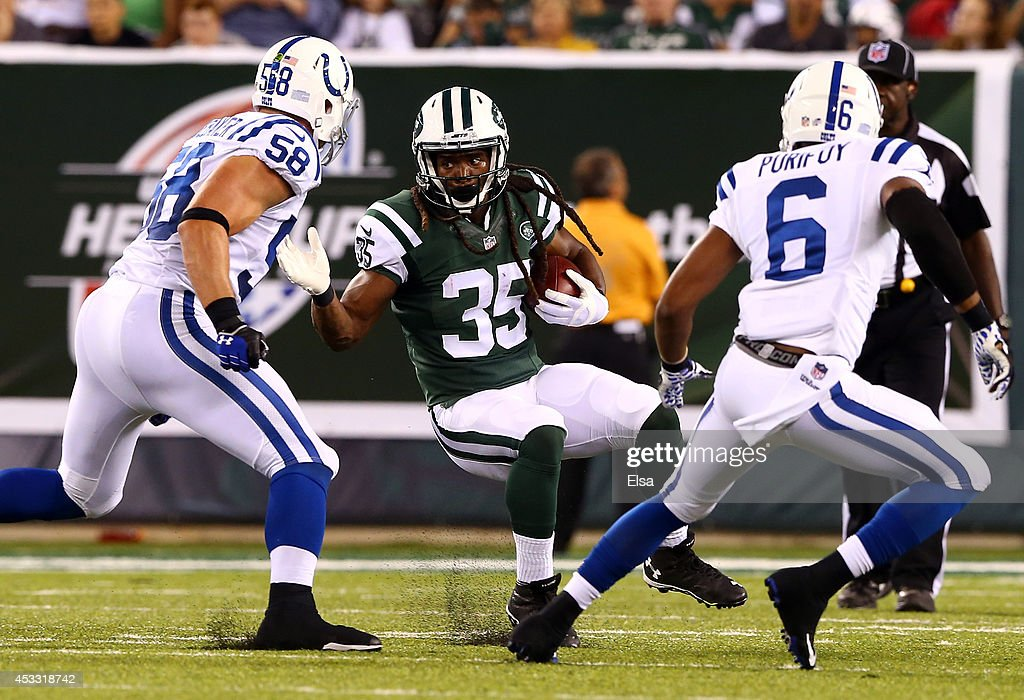 Running back Daryl Richardson #35 of the New York Jets carries the ball against the Indianapolis Colts during a preseason game at MetLife Stadium on August 7, 2014 in East Rutherford, New Jersey.