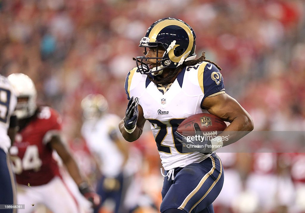 Running back Daryl Richardson #26 of the St. Louis Rams rushes the football against the Arizona Cardinals during the NFL game at the University of Phoenix Stadium on November 25, 2012 in Glendale, Arizona. The Rams defeated the Cardinals 31-17.