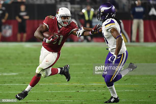 Running back David Johnson of the Arizona Cardinals carries the football against safety Anthony Harris during the first half of the NFL game at...