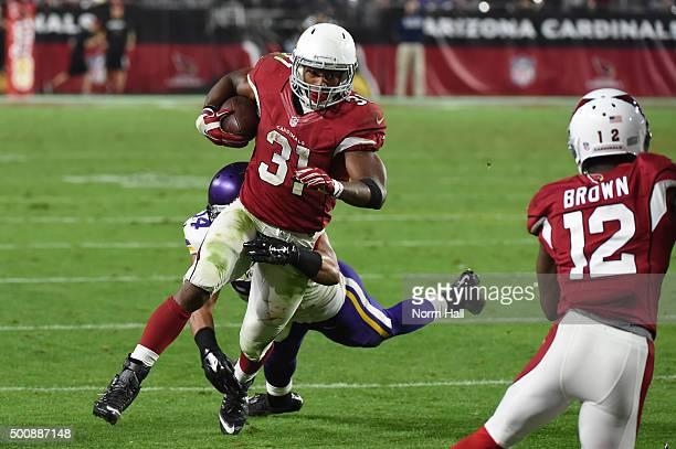 Running back David Johnson of the Arizona Cardinals carries the football against middle linebacker Eric Kendricks of the Minnesota Vikings at...